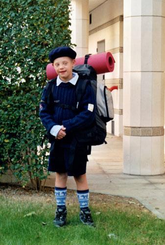 Jeune scout trisomique